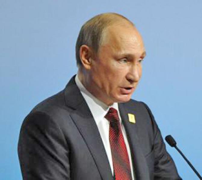 PUTIN: OCCIDENTUL ÎNCEARCĂ «SĂ PUNĂ URSUL RUS ÎN LANŢ»