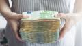 O femeie a avut in poseta citeva saptamini un bilet la loterie de 33 de milioane €, dar n-a stiut de el
