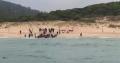 Zeci de imigranti fugariti de Politie au debarcat pe o plaja de nudisti